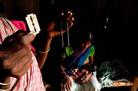 Ho tribes midwife showing thread and razor ; Chakradharpur ; Jharkhand ; India NO MR
