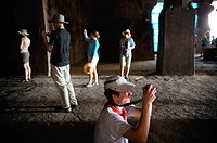 Foreign tourists shooting inside elephanta caves , Bombay Mumbai , Maharashtra , India NO MR