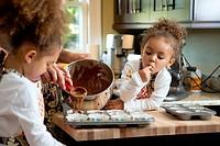 Girl tasting cupcake batter