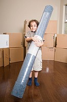 Boy Carrying Rug