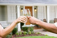 Husband and Wife Toast to Their New Home