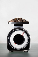 Coins on weight scale