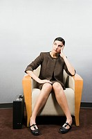 Businesswoman sitting in waiting room