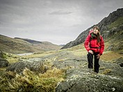 Woman hiking in rocky landscape