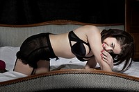 Woman wearing lingerie on bed