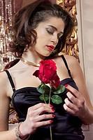 Woman in lingerie holding flower
