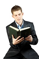 young man in a suit holding a book
