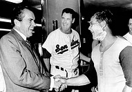 President Richard Nixon greets Washington Senators Catcher Jim French after their win over the Brewers. Manager Ted Williams is in center. July 7, 197...