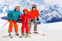 Portrait of family including girl 6_7 skiing