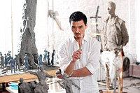 A male sculpturer standing in studio