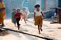 Children running on street ; Salunkhewadi ; Nandur ; Marathwada ; Maharashtra ; India MR688