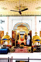 Granth at darbar hall of gurudwara patna sahib , Patna , Bihar , India
