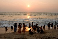 School children with their teachers enjoying sunset at cherai beach , Cochin , Kerala , India
