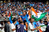Indian batsman Sachin Tendulkar is carried on the shoulders by his teammates as he waves the tricolour after India defeated Sri Lanka in the ICC Crick...