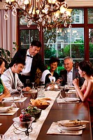 Luxury family having dinner together