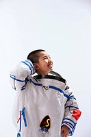 Boy wearing spacesuit