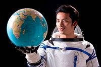 Astronaut holding a globe
