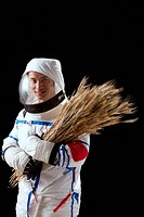 Astronaut holding wheat