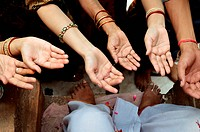 Women spreading hands take sacred thread the priest Achalnath temple Jodhpur Rajasthan India