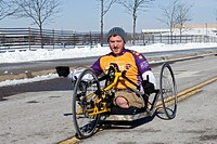 Sterling Heights, Michigan - Ben Maenza, who lost both legs while serving in the Marine Corps in Afghanistan, tests a handcycle prototype at the Gener...