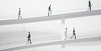 Business people walking along elevated walkway