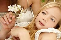 Close up of serene girl holding flower