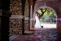 Bridal portrait - A young bride in wedding dress posing at historical looking building at Garner State Park, Concan, Texas, USA, Female Caucasian, 23 ...