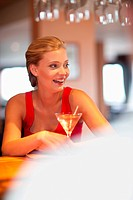 Woman having drink at bar