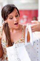 Woman looking in shopping bag