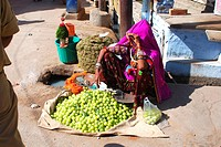 Rajasthani lady selling amla in Pushkar , Rajasthan , India