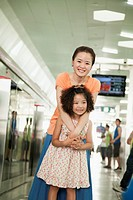 Chinese mother and daughter in subway station