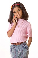 Nine year girl talking on mobile phone kept one hand in pocket of jeans pants MR748Q
