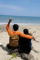 Man and woman enjoying at Havlock Radhanagar beach ; Andaman Islands ; Bay of Bengal ; India MR736J;736K  2008