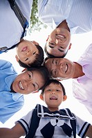 Chinese family smiling together outdoors
