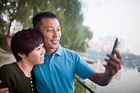 Chinese couple taking picture together