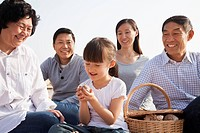 Chinese family picnicking on beach