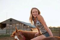 Caucasian girl sitting on horse