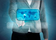 Businesswoman touching a world map on a futuristic screen
