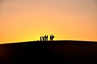 Silhouette of travelers at sunset