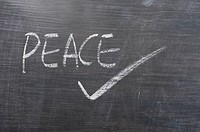 Peace _ word written on a blackboard
