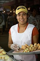 Oaxaca, Mexico, North America  Day of the Dead Celebrations  Young Lady Selling Pastries  Visits to the Cemetery take on a carnival, family atmosphere...
