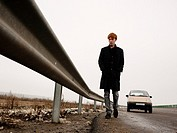 Young man on a highway in Romania