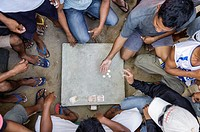 Men betting in the streets, Bulalacao, Mindoro, Philippines