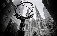 Manhattan, New York, USA  The Atlas Statue outside the Rockefeller Center, facing St Patrick's Cathedral  Atlas carries the heavens on his shoulders, ...
