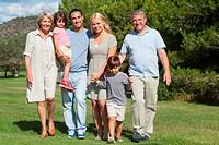 Multi_generation family portrait strolling through the park