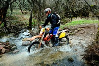 Biker fording a stream in Valdemorillo, Madrid