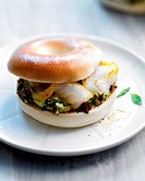 Avocado,cottage cheese and smoked fish bagel sandwich