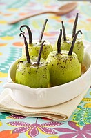 Roasted kiwis with vanilla,banana_giner sauce