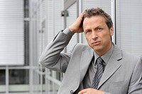 Europe, Germany, Bavaria, Close up of stress businessman