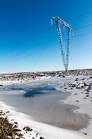 HIGH_VOLTAGE LINE, THE BEGINNING OF ROUTE F35, OR KJOLUR, IN THE SNoW, ROAD CROSSING THE HIGHLANDS OF ICELAND, SOUTHWEST ICELAND, EUROPE